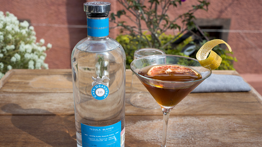 martini glass tequila cocktail with casa dragones bottle