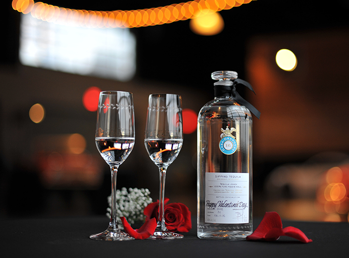 tequila casa dragones blanco and glasses valentines day red ribbon.